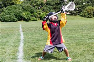 Youth lacrosse player catching ball